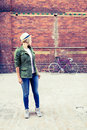 Hipster girl and vintage road bike in city Royalty Free Stock Photo