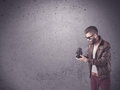 Hipster guy with vintage camera and beard