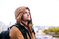 Hipster man with hood in the streets of london close up young brown winter jacket on head Stock Photography