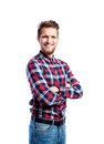 Hipster man in jeans and shirt, studio shot, isolated Royalty Free Stock Photo