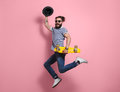 Hipster man jumping with longboard Royalty Free Stock Photo