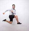 Hipster man jumping in photo studio