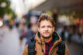 Hipster man walking in the streets of london close up young brown winter jacket Stock Photo