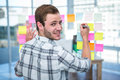 Hipster man writing on post-it Royalty Free Stock Photo