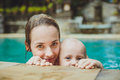 Hipster Mother play with her lovely child in swimming-pool, Bali Royalty Free Stock Photo