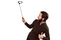 Hipster using his seflie stick Royalty Free Stock Photo