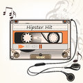 Hipster vector music background with old cassette and headphones Royalty Free Stock Photo