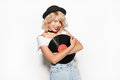Hipster woman with blond hair holding a vinyl record Royalty Free Stock Photo