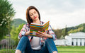 Hipster woman in casual clothes holding a book and reading Royalty Free Stock Photo