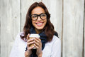 Hipster woman with take-away coffee