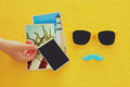 Hipster yellow sunglasses and funny moustache next to blank photographs Royalty Free Stock Photo