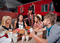 Hipsters with Plates of Pizza Royalty Free Stock Photo
