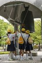 Students ringing the peace bell in Peace Memorial Park for world peace, Hiroshima Royalty Free Stock Photo