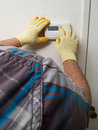 Hispanic airconditioning repair man performing maintenance Stock Images