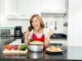 Hispanic beautiful woman cooking in modern kitchen Royalty Free Stock Photo