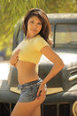 Hispanic beauty leaning against vintage pickup  Royalty Free Stock Image