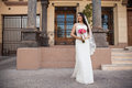 Hispanic bride outside a courthouse Royalty Free Stock Photo