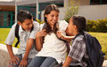 Hispanic Brothers and Sister Talking Ready for School Royalty Free Stock Photo