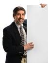 Hispanic businessman holding sign smiling blank isolated over white background Stock Photography