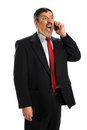 Hispanic Businessman Screaming in Phone Stock Photo