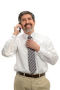 Hispanic businessman using cellphone mature isolated over white background Stock Image