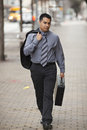 Hispanic Businessman - Walking With Briefcase Royalty Free Stock Image