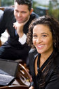 Hispanic businesswoman and male coworker in office Royalty Free Stock Photography