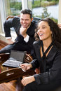 Hispanic businesswoman and male coworker in office Stock Photo