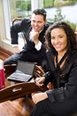Hispanic businesswoman and male coworker in office Stock Image