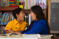 Hispanic child and mom receive big surprise from book Stock Photography