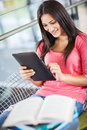Hispanic college student using tablet PC Royalty Free Stock Photos