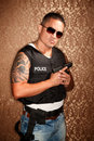 Hispanic Cop Holding Gun Stock Photos