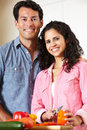 Hispanic couple cooking Royalty Free Stock Image