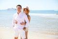 Hispanic couple enjoying a trip to the beach Royalty Free Stock Photo