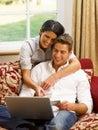 Hispanic couple at home online shopping Stock Photo