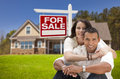 Hispanic Couple, New Home and For Sale Real Estate Sign Royalty Free Stock Photo