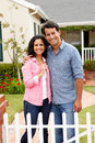 Hispanic couple outside new home Royalty Free Stock Images