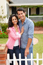 Hispanic couple standing outside home Royalty Free Stock Photography