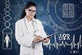 Hispanic doctor with stethoscope and holds clipboard Royalty Free Stock Photo