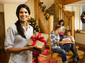Hispanic family at christmas exchanging gifts Royalty Free Stock Image