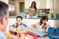 Hispanic Family Eating Breakfast At Home Before School Royalty Free Stock Photo
