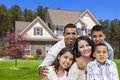 Hispanic family in front of beautiful house happy portrait Royalty Free Stock Photography