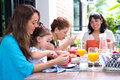 Hispanic family with a girl toddler having breakfast together Royalty Free Stock Photo