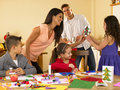 Hispanic family making Christmas cards Stock Image