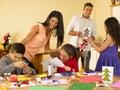 Hispanic family making Christmas cards Royalty Free Stock Photography