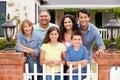 Hispanic family outside home Royalty Free Stock Photo