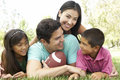 Hispanic Family In Park With Football Stock Photography