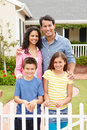 Hispanic family standing outside home Stock Photography
