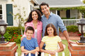 Hispanic family standing outside home Royalty Free Stock Photo