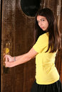 Hispanic girl opening door Royalty Free Stock Photo